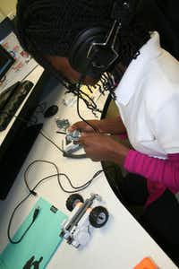 Jabria Wair-ray works at the robotics station at the George Washington Carver 6th Grade STEM Learning Center in Lancaster.