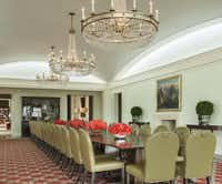 Both dining rooms have the same chairs, with drawer-pull handles on their backs to facilitate one-handed maneuvering. Blasingame ordered 46 of them to service large parties.