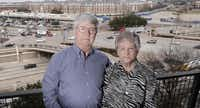 Larry and Linda Walton chose their condo across from Mockingbird Station knowing the pedestrian bridge was coming and have waited patiently for three years.(Ron Baselice - Staff Photographer)