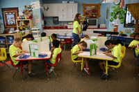 Kindergarten teacher Shirley Penson gives her students a spelling test at Leadership Prep School  in Frisco. The school, which opened in 2011, has more students on its waiting list than on its rolls.ROSE BACA  -  neighborsgo staff photographer