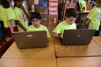 Fourth-grade students Cristian Cavazos (left) and Brooks Johnson work on an assignment.( ROSE BACA  -  neighborsgo staff photographer )