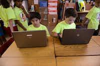 Fourth-grade students Cristian Cavazos (left) and Brooks Johnson work on an assignment.ROSE BACA  -  neighborsgo staff photographer