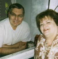 During prison visits, including this one in 2008, Les and Shari Bower communicate through a glass partition. They haven't touched each other in 27 years.