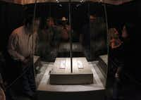 """Visitors stood in line for nearly two hours to see the """"victory or death"""" letter written by William Barret Travis at the Alamo on Saturday, the first day of the exhibit. Officials are anticipating at least twice as much traffic as usual at the site."""
