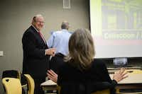 Bill Hidell, of Hidell and Associates Architects, reacts to input from local resident Deborah Brune on the expansion of William T. Cozby Public Library during a focus group meeting in Coppell. The library's continual growth means officials are now planning a $5 million renovation of the 28,000-square-foot building, and are hosting a series of focus group meetings to gather public input.( Rose Baca )
