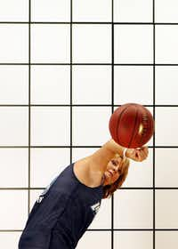 """Nancy Lieberman spins a basketball while being taped for a video that will become part of the motion-lab exhibit. """"People are going to come in and see these great male athletes, but also a female athlete,"""" she said. """"I'm glad it's me."""""""