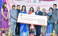 The Texas Indo-American Physicians Society presented a $10,000 check to Life Again Foundation representatives at a fundraiser at the Patel Center in Irving.( KV Photography )