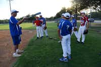 Chris Corso, head coach of the Junior South Garland Allstars, talks to players during a practice at Central Park in Garland. The teams operate at a flat cost of $70, which includes full uniforms, trophies and refreshments.(Photo by ROSE BACA - neighborsgo staff photographer)