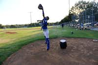 Junior South Garland Allstars player Peter Alcazar jumps to catch a ball duringpractice.Photo by ROSE BACA - neighborsgo staff photographer