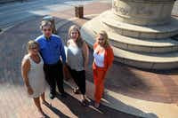 Oak Lawn Committee members (from left) Gretchen Kelly, Michael Milliken, Brenda Marks and Donna Fishel have been the force behind maintaining the Legacy of Love Monument in Oak Lawn, which was designed to be a celebration of the community, but has also become the site of five car accidents, causing the Oak Lawn Committee to spend nearly $15,000 to repair it. If the group doesnÕt raise more to compensate, the group can only afford three more years of maintenance.