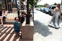 Brothers Jasper Gooden, 2, and Felix Gooden, 4, stand outside Steel City Pops on Lower Greenville.Photos by ROSE BACA - neighborsgo staff photographer