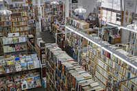 The north Oak Cliff bookstore, stuffed with used books, magazines, records and videos, has wanted for customers since opening three years ago. Owner John Tilton hopes to find a new location, but times are tough in the age of e-books.( Jim Tuttle  -  Staff Photographer )