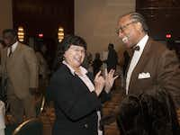 Dallas County Sheriff Lupe Valdez and Commissioner John Wiley Price, both recently re-elected, talked before Tuesday's ceremony at the Hyatt Regency Dallas.