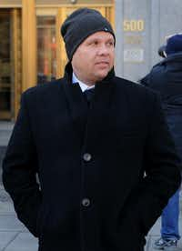 George Perez, a former programmer at Bernard L. Madoff Investments Securities LLC, exits federal court during a lunch break in New York, U.S., on Friday, March 21, 2014. The jury deciding the fate of five of Bernard Madoff's former employees charged with aiding his $17.5 billion Ponzi scheme will resume deliberations today with 11 members after one fell ill and was dismissed by a judge. Photographer: Louis Lanzano /Bloomberg *** Local Caption *** George PerezLouis Lanzano - Bloomberg