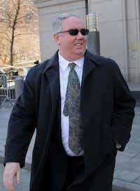 Jerome O'Hara, a former computer programmer for Bernard L. Madoff Investment Securities LLC, exits federal court during a lunch break in New York, U.S., on Friday, March 21, 2014. The jury deciding the fate of five of Bernard Madoff's former employees charged with aiding his $17.5 billion Ponzi scheme will resume deliberations today with 11 members after one fell ill and was dismissed by a judge. Photographer: Louis Lanzano /Bloomberg *** Local Caption *** Jerome O'HaraLouis Lanzano - Bloomberg