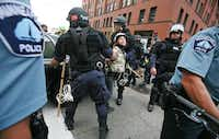 Police arrested a protester in downtown St. Paul at a march led by Poor People's Economic Human Rights Campaign during the Republican National Convention. Clashes with violent protesters led to more than $25,000 of damage to downtown businesses and property. Still, the convention ended as a huge success for St. Paul.File 2008