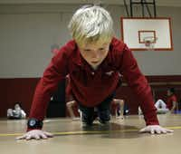 Luke Travis, 10, finds his form in P.E. class at Las Colinas Elementary School.