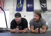 Jacob Schick (left), an injured military veteran, works on physical training with David Vobora, a former NFL linebacker who trains both injured veterans and disabled athletes at his Performance Vault gym in Dallas.( David Woo  -  Staff Photographer )