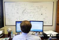 "Jake Herbert III of the Institute for Creation Research works in the shadow of research on the Big Bang theory's main assumptions. The center has a staff of 49 and an annual budget in the $7 million range. Some researchers call the institute's work ""pseudo-science.""Photos by Tom Fox - Staff Photographer"