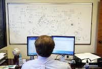 """Jake Herbert III of the Institute for Creation Research works in the shadow of research on the Big Bang theory's main assumptions. The center has a staff of 49 and an annual budget in the $7 million range. Some researchers call the institute's work """"pseudo-science.""""Photos by Tom Fox - Staff Photographer"""
