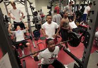 "Montray Roberts, a deaf varsity football player at Woodrow Wilson High School, spots spots Caleb Vallet as they work out with weights. ""They need to be competitive to deal with the life issues they will face,"" said Montray's mother, Lasheka Jones."