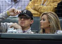Johnny Manziel and Colleen Crowley attended a Texas Rangers game in this AP file photo.