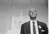 A. Philip Randolph, one of the chairmen for the March On Washington demonstration in Washington D.C., stands in front of the Lincoln Memorial following the two-pronged parade through the streets of the capital, Aug. 28, 1963.