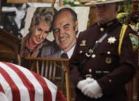 A photograph of former Democratic U.S. senator and three-time presidential candidate George McGovern and his late wife Eleanor, sits next to Sen. McGovern's casket during a public viewing at the First United Methodist Church in Sioux Falls, S.D., Thursday, Oct. 25, 2012. McGovern died Sunday in his native South Dakota at age 90. (AP Photo/M. Spencer Green, Pool)M. Spencer Green
