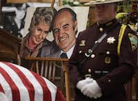 A photograph of former Democratic U.S. senator and three-time presidential candidate George McGovern and his late wife Eleanor, sits next to Sen. McGovern's casket during a public viewing at the First United Methodist Church in Sioux Falls, S.D., Thursday, Oct. 25, 2012. McGovern died Sunday in his native South Dakota at age 90. (AP Photo/M. Spencer Green, Pool)(M. Spencer Green)