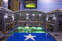 Lego builders created a replica of Cowboys Stadium in Arlington at the Legoland Discovery Center in Grapevine, complete with its signature video board.