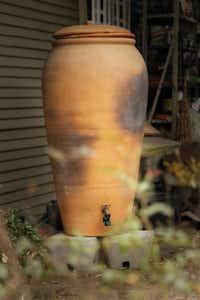 The terra-cotta rain barrel from Regalos de la Tierra in Oaxaca, Mexico at Mariana Greene's house in Dallas, TX on January 29, 2013.