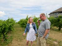 Gretchen Kuhns and Jayson Miller tour the vineyard at Chateau Chantal Winery during their Michigan vacation.( Susan R. Pollack )