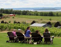 Visitors savor the view of the vineyards and bay at Chateau Chantal Winery on the Old Mission Peninsula near Traverse City, Mich.( Photos by Susan R. Pollack  -  Special Contributor )