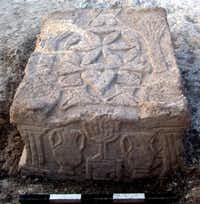A handout picture released on September 11, 2009 by the Israel Antiquities Authority shows a stone engraved with a seven-branched menorah (candelabrum) at the site where a synagogue from the Second Temple period (50 BCE-100 CE) was discovered at Migdal beach, near Nazareth. The synagogue that was uncovered joins just six other synagogues in the world that are known to date to the Second Temple period.(- -  AFP/Getty Images )