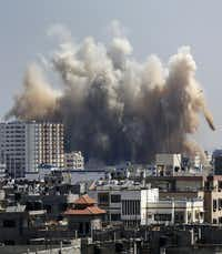 Smoke, dust and debris rise over Gaza City after an Israeli strike Friday.(Hatem Moussa - AP)
