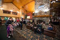 The welcoming  multipurpose lobby and lounge area at Fernie's Lizard Creek Lodge is perfect for relaxing or socializing. It features Wi-Fi and a four-sided fireplace.(Resorts of the Canadian Rockies - Fernie Alpine Resort)