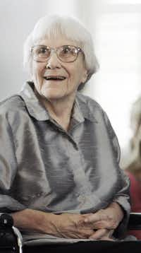 """FILE - In this Aug. 20, 2007, file photo, author Harper Lee smiles during a ceremony honoring the four new members of the Alabama Academy of Honor at the Capitol in Montgomery, Ala. Lee, author of """"To Kill a Mockingbird,"""" said she never gave her approval to a new memoir that portrays itself as a rare, intimate look into the lives of the writer and her older sister in small-town in Alabama. """"Rest assured, as long as I am alive any book purporting to be with my cooperation is a falsehood,"""" Lee said in a letter released Monday, July 14, 2014.Rob Carr  -  AP"""