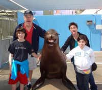 The Monday family - Chet, Dick, Tiffany and Lily - at SeaWorld San Antonio.