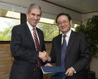 UTA president James Spaniolo (left) and Fangchun Yang, vice president at Beijing University of Posts and Telecommunications, signed a degree agreement Tuesday.