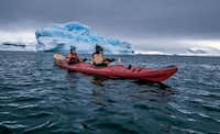 One of the best ways to explore the Antarctic coastline is by sea kayak, an increasingly popular optional activity on many adventure programs.(Mark Sissons)