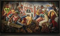 The Talladega murals, which are considered Hale Woodruff's greatest artistic achievement, are on exhibit at the African-American Museum in Dallas, Texas. The landmark touring show is considered to be some of the most poignant depictions of slavery ever painted. Dr. Harry Robinson, left, director of the museum, and Phillip Collins, the curator of the show, posed for pictures Wednesday morning, September 26, 2012.