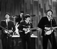 "The Beatles perform on the ""Ed Sullivan Show."" An estimated 73 million Americans tuned in, the largest ever for a TV show at the time."