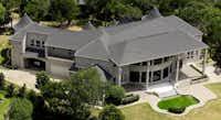 Dr. Tariq Mahmood owns a 10,000-square-foot house in Cedar Hill.