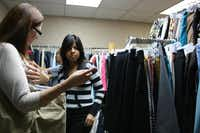 The Main Place volunteer Marsha Dickens helps Nimitz High School student Betty Herrera, 16, pick out clothes at the nonprofit in downtown Irving. The Main Place provides clothing to teenagers who have been referred by Irving ISD and are categorized as homeless.Photos by GLORIA HERNANDEZ