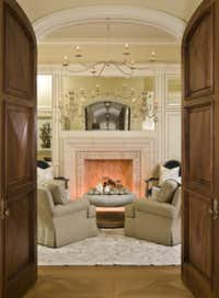 There are multiple formal and casual living areas in the home, plus a study, library, gourmet kitchen, keeping room, three wet bars, outdoor kitchen and living area, media room, 14-car garage and pool house.(Sean Gallagher)