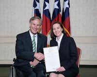 Then-Attorney General Greg Abbott presented Martha Fitzwater Pigott with an award on July 8, 2008. (Texas attorney general's website)