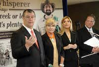 """Local mayors (from left) Mike Rawlings of Dallas, Betsy Price of Fort Worth, Beth Van Duyne of Irving and Robert Cluck of Arlington gathered at Dallas/Fort Worth International Airport last month to pledge support for making water restrictions permanent. The backdrop behind them features the """"Lawn Whisperer,"""" part of a regional water conservation campaign."""