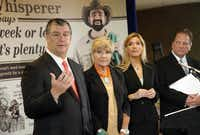 "Local mayors (from left) Mike Rawlings of Dallas, Betsy Price of Fort Worth, Beth Van Duyne of Irving and Robert Cluck of Arlington gathered at Dallas/Fort Worth International Airport last month to pledge support for making water restrictions permanent. The backdrop behind them features the ""Lawn Whisperer,"" part of a regional water conservation campaign."