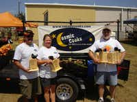 Steve Mayberry (right) and Cosmic Cooks teammate David Calvery and his wife, Kelly, display trophies the team won for its barbecue at the Wichita Falls East VFD BBQ Cookoff in 2006.