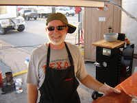 Steve Mayberry prepares meat at the 2008 Great American Barbecue in Kansas City. Qualifying for and participating in the well-known competition was a highlight of the Cosmic Cooks' accomplishments, said fellow team member David Calvery.